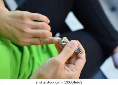 Women cut fingernails