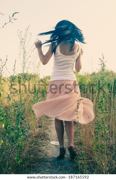 Women  dancing outdoors colorized image. Blurred motion