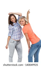 Women dancing together on white background
