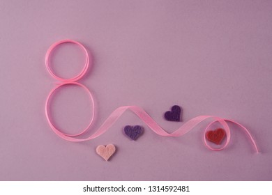 women day template with ribbon and hearts on purple