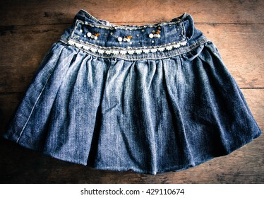 Women denim skirt on wooden background,Women jean skirt, Women miniskirt,Denim fashion design