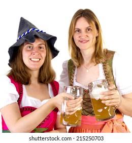 Women in dirndl clinking glasses