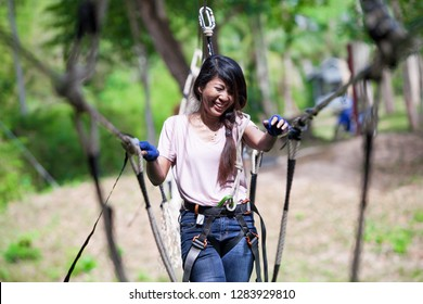 Women Do Challenging Adventure Activities on the Rope.