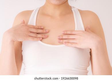 Women doing self-checks for breast cancer