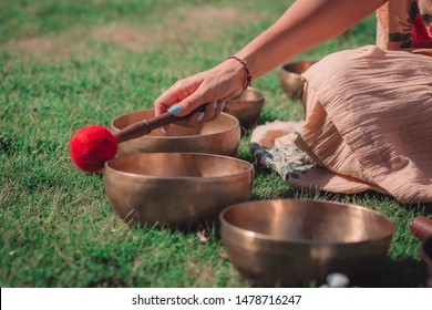 Women doing sound massage and healing therapy with singing bowls