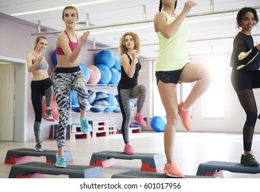 Women doing stepping trainings in group