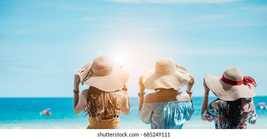 The women dressed in Bohemian clothing style is relaxing on the beach in vacation time.