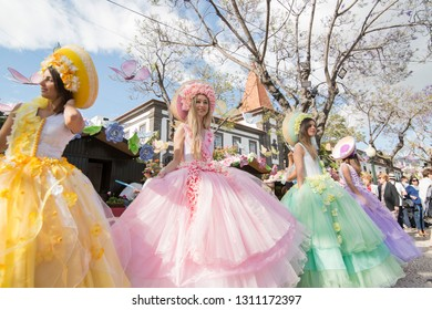 women dressed in colorful clothes at the Festa da Flor or Spring Flower Festival in the city of Funchal on the Island of Madeira in the Atlantic Ocean of Portugal.  Madeira, Funchal, April, 2018