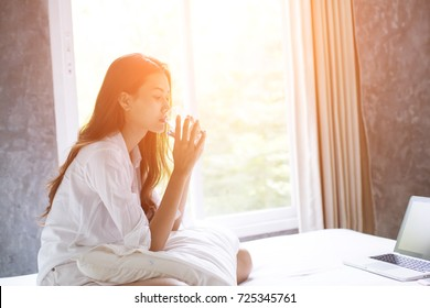 Women drink water after wake up in the morning