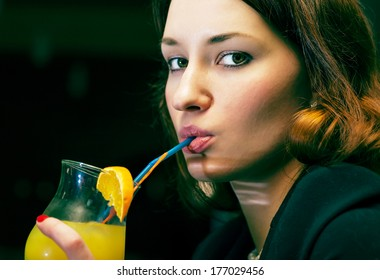 women drinking cocktail colorized image