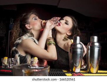 Women drinking shots of tequila