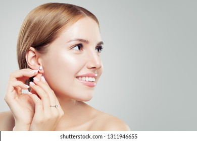 Women earring jewelry model. Cheerful woman with diamond earrings and ring, beautiful face closeup