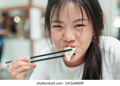 Women are eating Gyoza ,Women are eating Gyoza Japan ,Gyoza