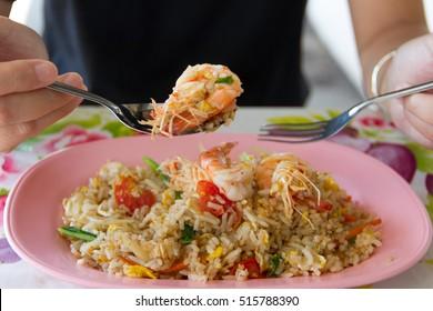 Women eating Shrimp fried rice