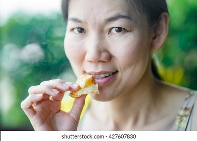 Women eating sweet pineapple pie