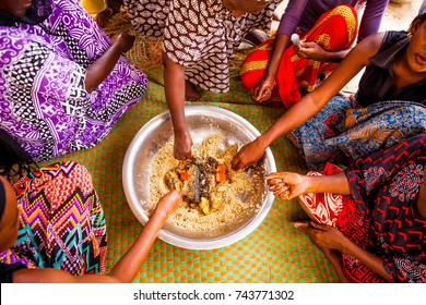 Women eating together in Senegal in the traditional manner.