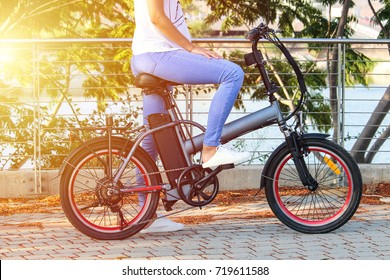 Women with electric ebike With lake view