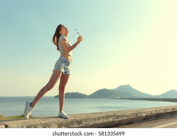 Women enjoy relax and drinking water.