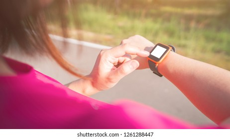Women exercise in the morning with SmartWatch.