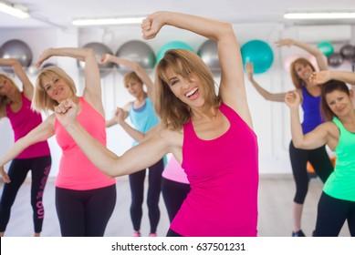 women exercising at gym