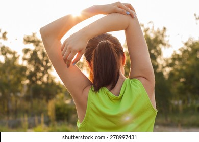 Women exercising.Women exercising in sunny bright light.