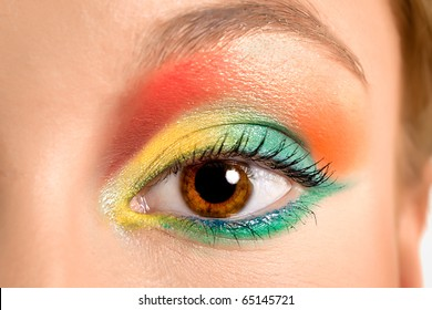 Women eye, close-up, painted in different colours