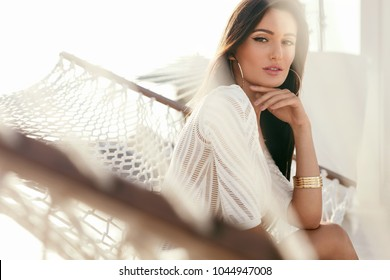 Women Fashion. Female In Fashionable Clothes Relaxing In Summer