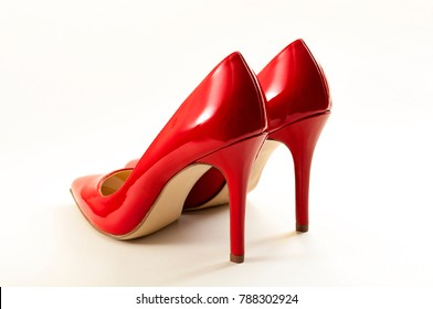 Women fashion and stylish footwear concept with a pair of red high heel stilettos isolated on white with a clipping path included
