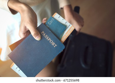 Women filing their passports, air tickets, credit cards Luggage.