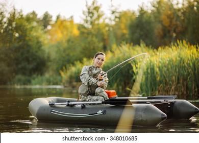 Women Fisherman on the lake background
