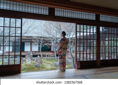 Women Floral Printed Long Kimono  in traditional Japanese courtyard house.