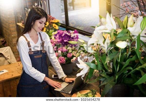 Women Florist Looking Laptop Got Order Stock Photo Edit Now