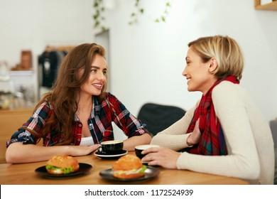 Women Friends In Cafe Drinking Coffee