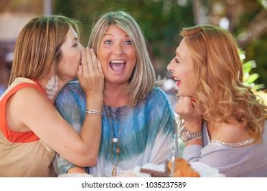 women friends  gossiping scandal