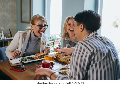 women friends having lunch break at restaurant