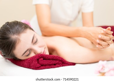 Women is getting her Back massage on a Spa bed
