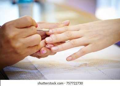 Women getting treatment at nail salon