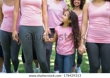 Women and girl participating in breast cancer awareness at park