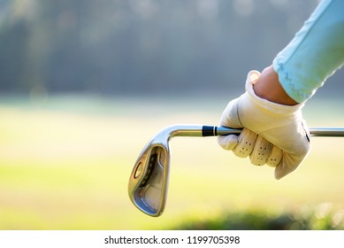 Women golfer Using golf clubs To help twist To warm up body before the play game, with blurred soft nature background,Lifestyle Concept. Sport Concept