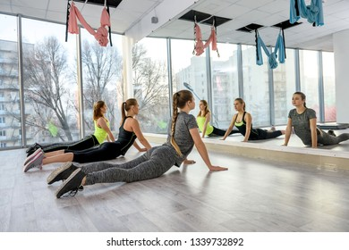 Women in gym making exercising for back muscles