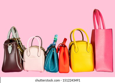 Women hand bag collection on pink background.