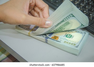Women hand counting US Dollar bills. Woman counting money, Cash in hands. Profits, savings. Stack of dollars. Success, motivation, financial flows, wealth. Stack of dollars,dollars in hand.