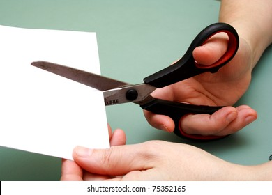 women hand is cutting paper with scissors