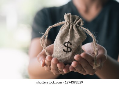 Women hand hold a money bag, a loan or saving money for future investment concept.