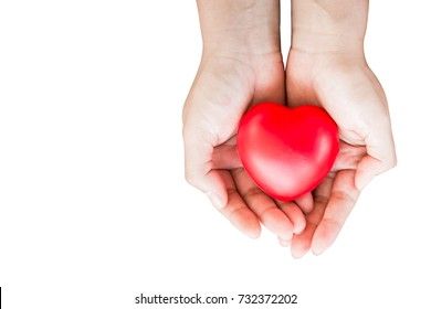 Women hand hold a red heart with clipping path and copy space on white background, Health insurance concept.