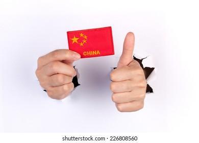 Women Hand Holding China Flag isolated on white