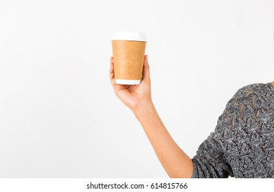 Women hand holding Disposable coffee cup isolated on white background.