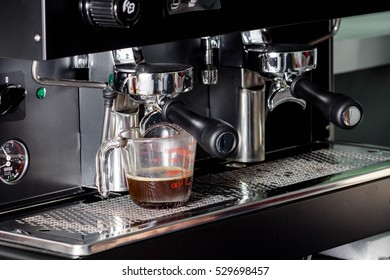 women hand making coffee in coffee machine