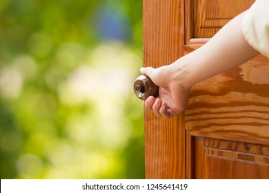 Women hand open door knob or opening the door,grand opening,Close up hand open door.