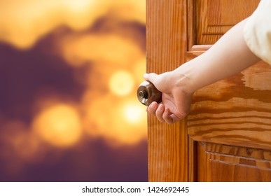 Women hand open door knob or opening the door,grand opening,Close up hand open door.